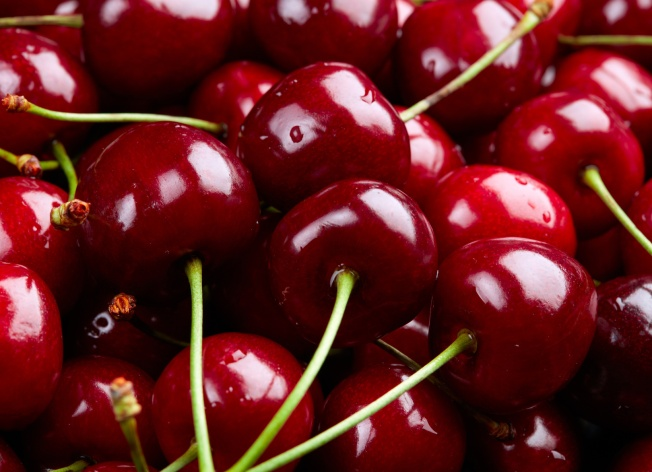Cherry Background. Sweet organic cherries on market counter