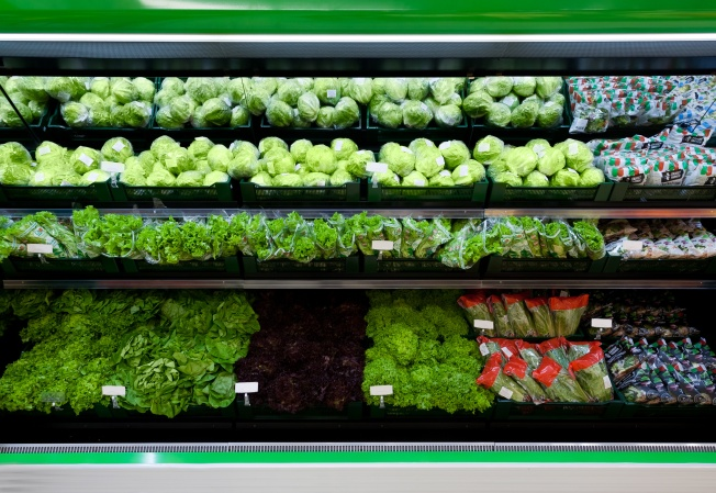 Supermarket vegetables showcase with cabbage and salad